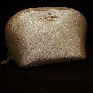 Kate Spade gold makeup bag.  NEW!